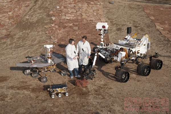 3 Generations of Mars Rovers plus dudes